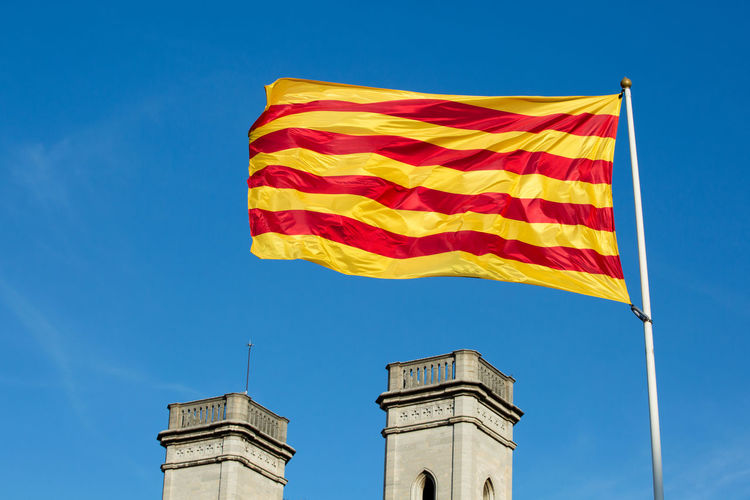 Sky Flag Low Angle View Blue Nature Architecture No People Patriotism Day Wind Building Exterior Built Structure Sunlight Environment Striped Clear Sky Outdoors Waving Yellow Towers Catalunya Catalunya Flag Catalonia Autonomy Proud