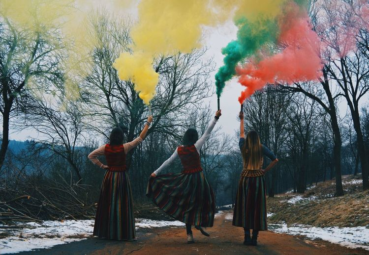 Rear View Of Women With Distress Flare Standing On Road During Winter