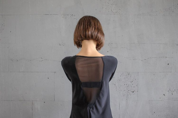 EyeEmNewHere EyeEm Best Shots EyeEm Selects One Person Rear View Hairstyle Waist Up Women Hair Standing Wall - Building Feature Adult Young Adult Gray Brown Hair Fashion Human Back Indoors  Contemplation Clothing Looking Teenager