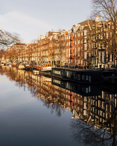 Amsterdam Reflection Canal Amsterdam EyeEm Selects Building Exterior Water Built Structure Architecture Reflection Building City Nautical Vessel Moored House Waterfront Mode Of Transportation Residential District Transportation Outdoors