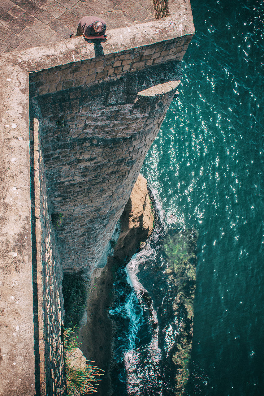 rock - object, day, no people, sea, water, outdoors, nature, blue, cliff, built structure, architecture, beauty in nature