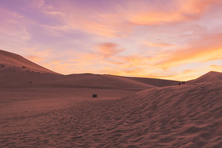 Arid Climate Beauty In Nature Cloud Cloud - Sky Desert Golden Hour Huacachina Huacachina, Peru Idyllic Landscape Mountain Mountain Range Nature Non-urban Scene Orange Color Outdoors Physical Geography Remote Scenics Sky Sunset Sunset_collection Tranquil Scene Tranquility Travel Destinations
