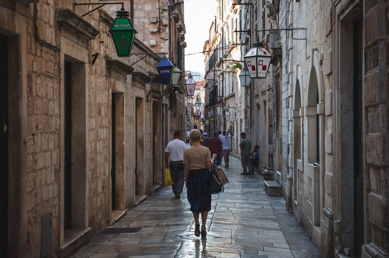 Old town Dubrovnik Dubrovnik, Croatia Architecture Built Structure Building Exterior Walking Rear View Men Street Alley Real People Women Full Length Lifestyles City Outdoors