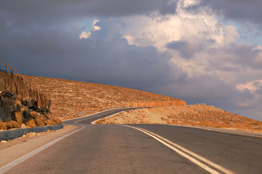 Copy Space Crete Greece Desert Drought Loneliness Nature Ominous Plakias South Of Crete Tranquility Beauty In Nature Cloud - Sky Countryside Golden Hour Heat Mountain Range No People Rural Scene Sunset Tranquil Scene Travel Destinations Winding Road Yellow Crete