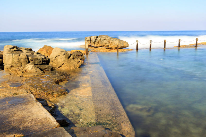 Slow down capture of the Mahon Rock Pool, with smooth waves and water Swimming Beach Beauty In Nature Clear Sky Day Horizon Over Water Mahon Pool Nature No People Outdoors Pool Rock - Object Rock Pools Scenics Sea Sky Swimming Pool Tranquil Scene Tranquility Travel Destinations Water