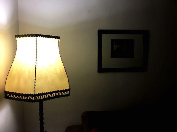 Close-up of illuminated lamp at home