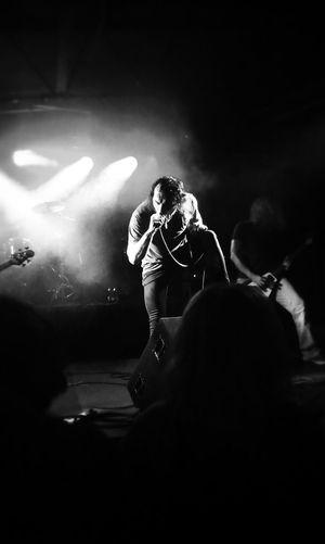 Man singing in concert