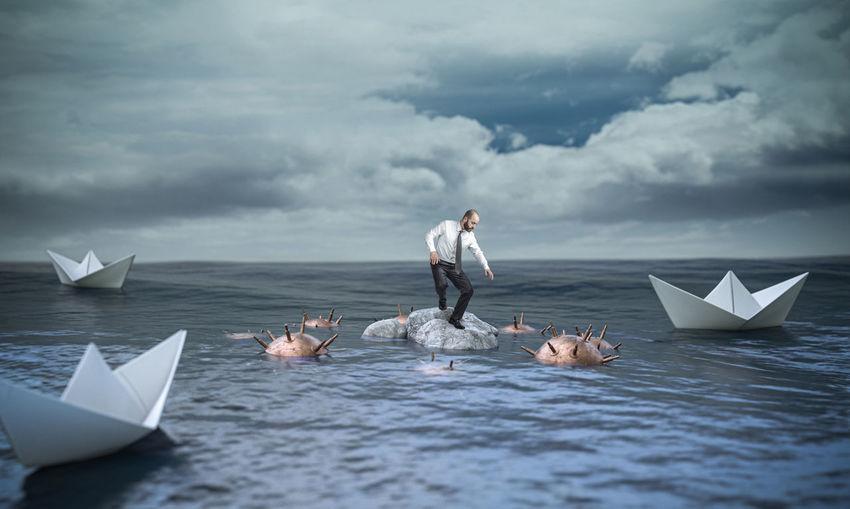 Digital composite image of man floating on sea against sky