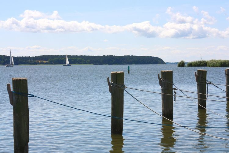 Water Sea Fishing Wooden Post Tranquility Outdoors Day No People Vacations Nature Sky Close-up Sailing Vessel Landing Stage Sailing Summer Rope Sailboat Yacht Yachting Sport Sailing Ship Nautical Vessel Baltic Sea Sun Pier