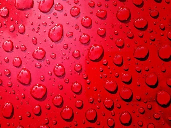Full frame shot of wet red table