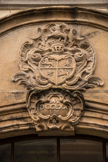 Old historical building with coats of arms made of stone Architecture Craft No People Carving - Craft Product History The Past Ornate Art And Craft Building Exterior Built Structure Low Angle View Bas Relief Close-up Symbol Day Religion Entrance Representation Creativity Façade Carving