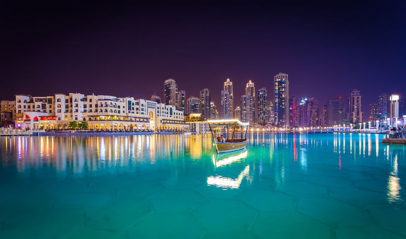 Marina Dubai Building Exterior Architecture City Building Built Structure Night Illuminated Sky Water Reflection Urban Skyline Residential District Cityscape Landscape Skyscraper Office Building Exterior Travel Destinations City Life Nature Harbor Modern Apartment Luxury Marina