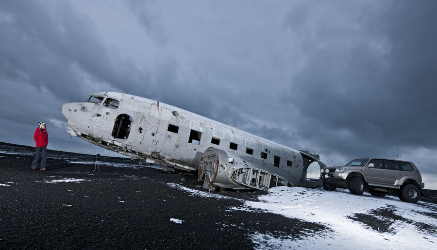 Abandoned airplane against sky during winter