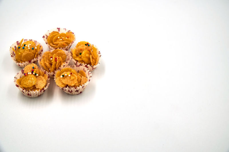High angle view of cake against white background