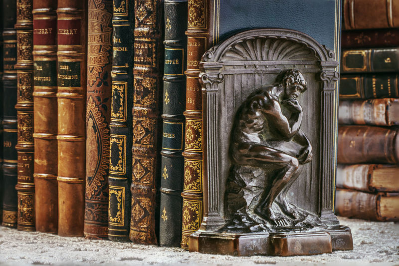 Statue of woman on book