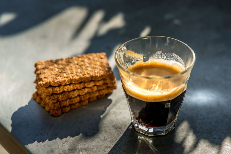Close-up of coffee and drink on table