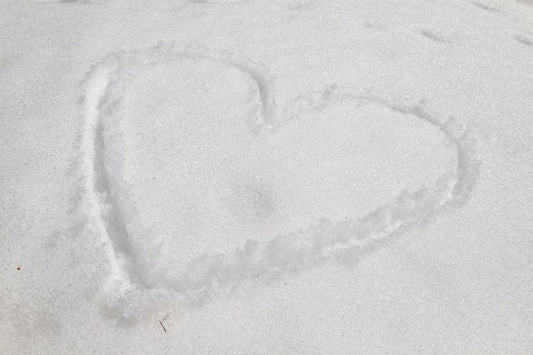 High angle view of heart shape on snow
