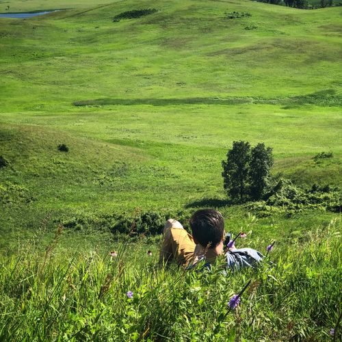 Capturing the prairie Landscape_photography Landscape_Collection EyeEm Best Shots - Landscape EyeEm Nature Lover Green Color Plant Grass Growth Field Land One Person Nature Day Real People Sunlight Beauty In Nature Landscape High Angle View Outdoors Agriculture Men