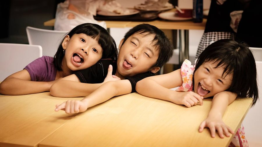 Portrait Of Three Funny Children