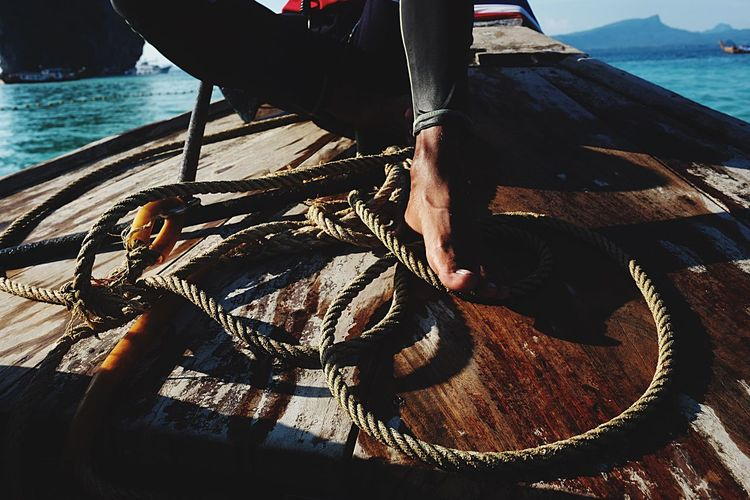 Wood - Material One Person Real People Day Sea Men Human Body Part Water Outdoors Sunlight Low Section Working Human Hand Fisherman Nautical Vessel One Man Only Nature Close-up People