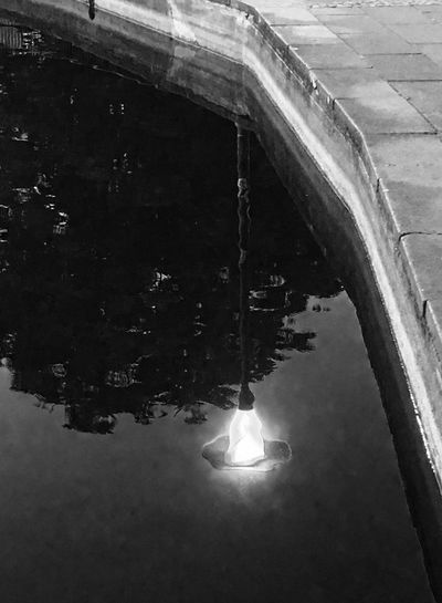 Close-up of illuminated reflection in water