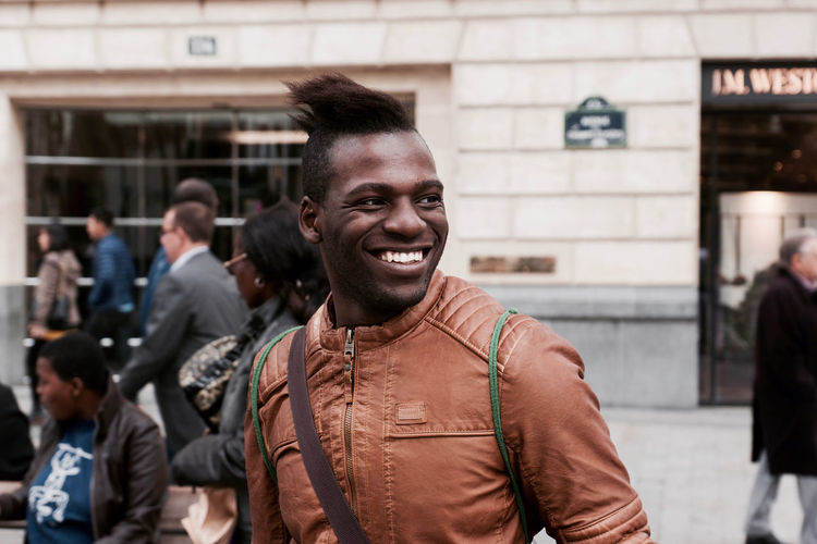 The Black man on the Street Casual Clothing City City Life Day Focus On Foreground Front View Jacket Leisure Activity Lifestyles Mid Adult Men Outdoors Paris Person Porta Portrait The Portraitist - 2016 EyeEm Awards The Street Photographer - 2016 EyeEm Awards Toothy Smile Young Men
