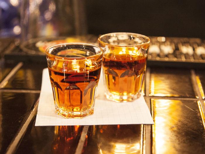 Close-up of fresh liquor drinks on bar counter