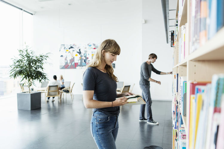 Young couple standing on book