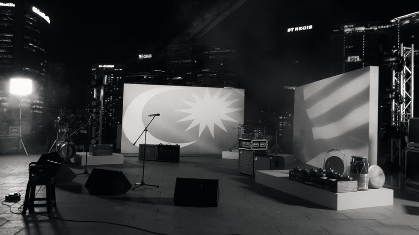A Malaysian concert. Live StageLive Music Photography Projection Mapping Malaysian Flag Stage Merdeka Rooftop Rooftop Concert Arts Culture And Entertainment Film Industry Shoot Microphone Black And White Samsung S8 Night Concert Flags Flag Malaysia Textures Textured Wall Breathing Space Mix Yourself A Good Time Rethink Things Black And White Friday Modern Workplace Culture