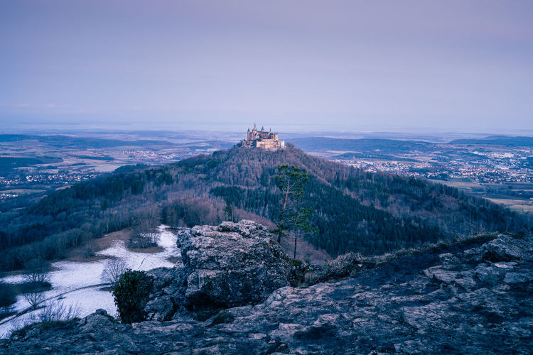 Elevated view of hohenzollern castle at sunrise, winter landscape, baden wuerttemberg, germany