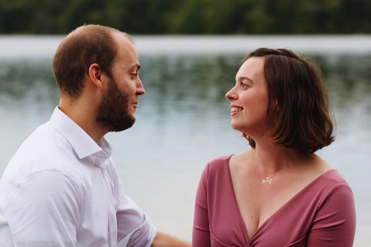 Portrait of young man with woman in lake