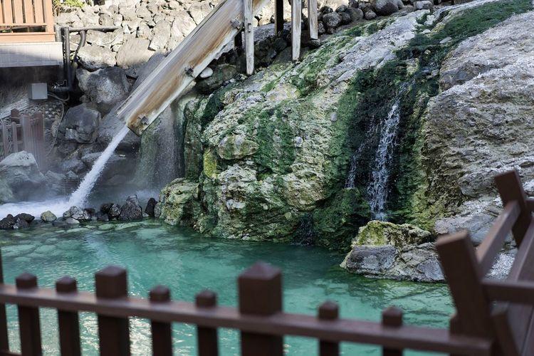 温泉 Water Rock Rock - Object Solid Nature Waterfall Flowing Water Beauty In Nature Day Tourism Outdoors Motion