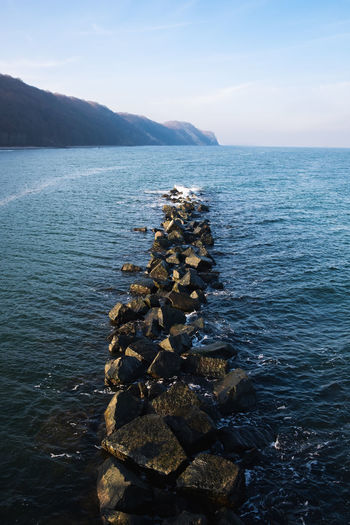 Water Sea Scenics - Nature Sky Beauty In Nature Rock Tranquil Scene Tranquility Solid Nature Rock - Object No People Non-urban Scene Day Mountain Idyllic Outdoors Stack Stone - Object