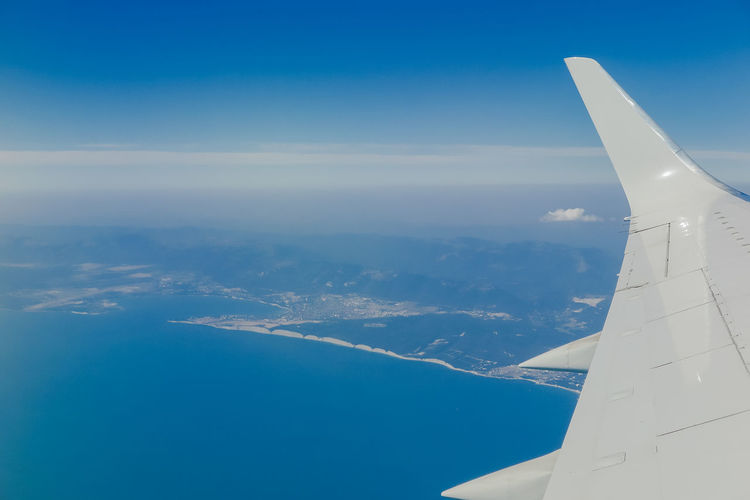 View from the landing plane from the window to the black sea and the coast Air Vehicle Airplane Aircraft Wing Flying Sky Travel Mode Of Transportation Transportation Scenics - Nature Nature Motion No People Cloud - Sky Blue Beauty In Nature Mid-air on the move Environment Day Public Transportation Outdoors