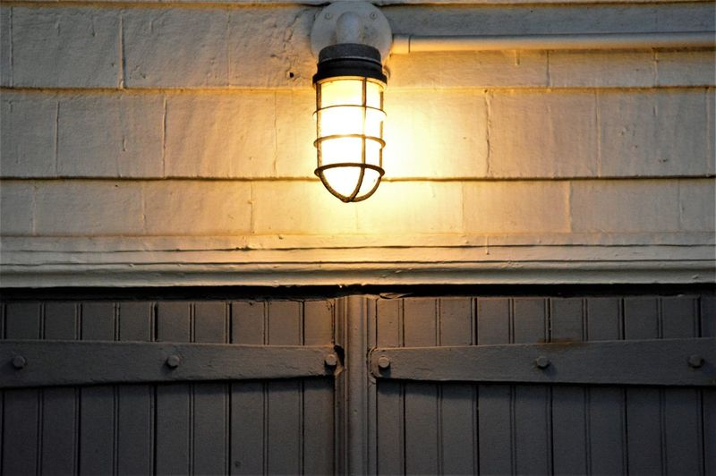 Beach Night Light Garage Door Hinge Light Outdoor Lighting Virginia Beach Beach Light Built Structure Close-up Electric Lamp Electric Light Electricity  Glowing Hinges Illuminated Light Light Bulb Light Fixture Lighting Equipment Low Angle View Metal Hinge No People Pattern Wall - Building Feature Wood - Material Wooden Doors