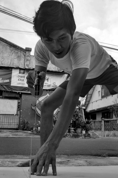 Young Adult Outdoors Looking Down Blackandwhite Real People Occupation Phonegraphy Phonegraphy_indonesia