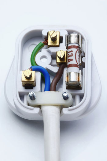 FUSE Plug Blue Cable Close-up Colored Background Connection Electricity  Electricity  Fuel And Power Generation Gray Gray Background Indoors  Metal No People Open Silver Colored Single Object Socket Still Life Studio Shot Three Pin Plug White Background White Color Wire