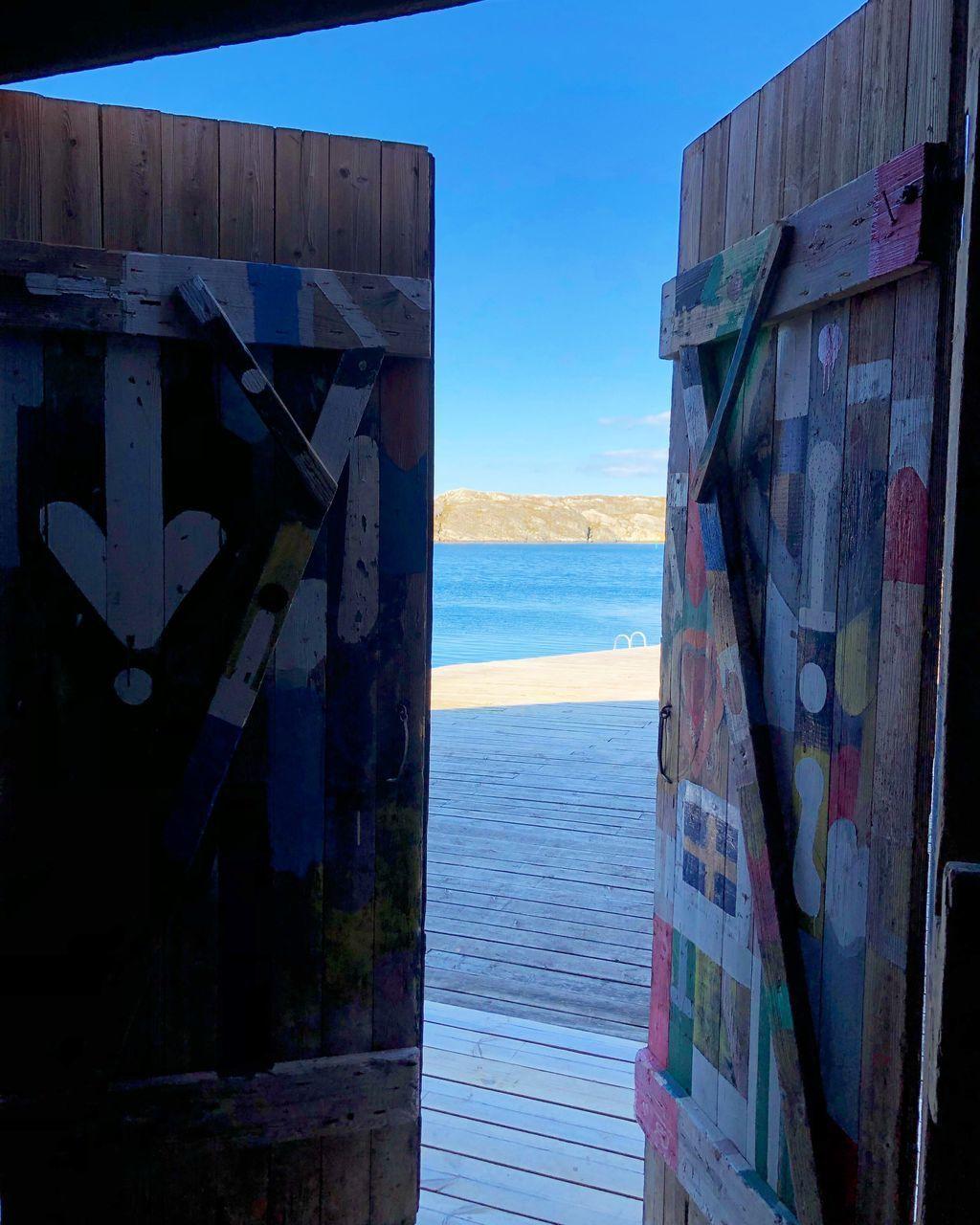 GRAFFITI ON BEACH AGAINST SKY