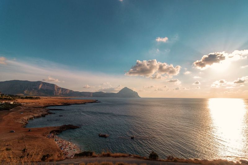 Summer mood in Sicily, beautiful view at sunset. Photography Horizon Sicily Summervibes Summertime Italy Outdoors Sunlight Non-urban Scene Land Beach Idyllic Reflection Sunset Nature Mountain Tranquility Cloud - Sky Tranquil Scene Beauty In Nature Sea Scenics - Nature Water Sky