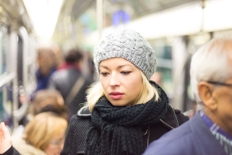 Portrait of beautiful woman in train during winter