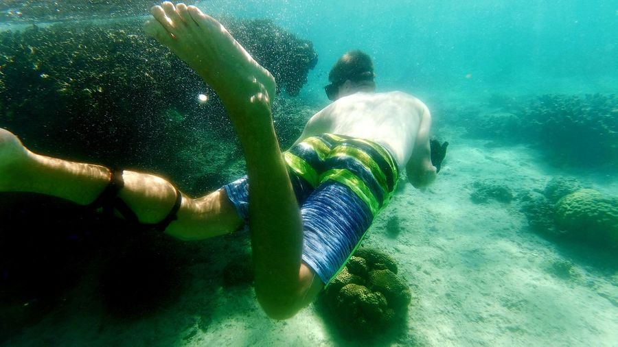 People swimming in sea
