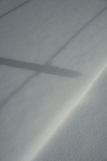 High angle view of shadow on white surface