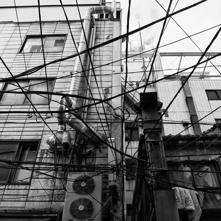 Built Structure Architecture Building Exterior Low Angle View No People Street Streetphotography B&w Street Photography Streetphotography_bw View On The Road CityWalk Snapshot Power Line  Kanda 神田 , Tokyo Japan The Architect - 2017 EyeEm Awards