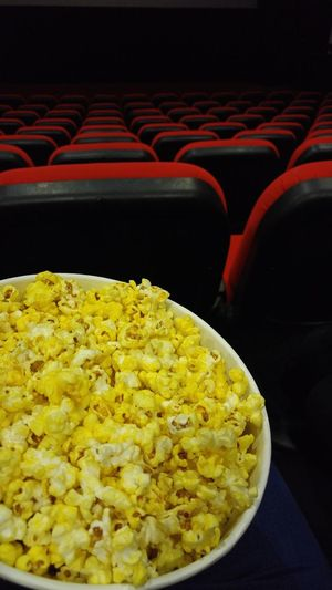Food And Drink Yellow Food Red Abstract View Cinema Food And Drink Cinema In Your Life Popcorns Popcorn🌽👌 PopcornTime Popcorn & A Movie  Red Chairs Cinema Chairs Cinema Time CinemaTime Cinema And Popcorn Ready-to-eat