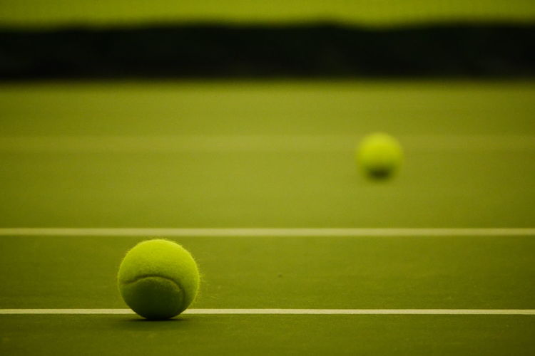 Ball Green Color Sport Textured  Backgrounds No People Tenniscourt Tennisball Tennis Ball Tennis Court Sports Venue Indoors  Indoors  Indoors  Close-up Green Color Racket Sport