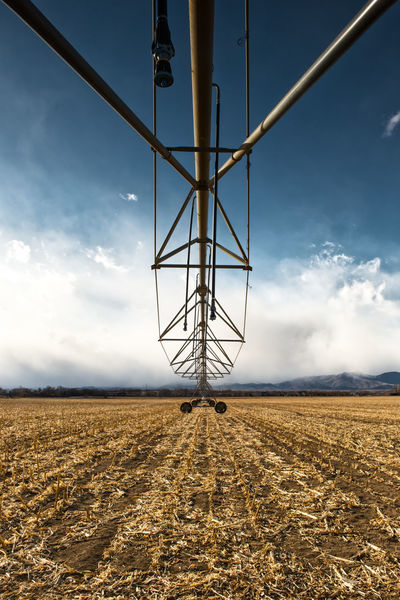 A field irrigation machine. Colorado Field Irrigation Equipment Machinery POV Equipment Farm Equipment Farm Machinery Heavy Machinery Irrigation No People Sky With Clouds