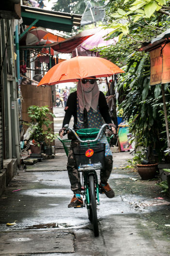 Bangkok Bangkok Thailand. Bicycle Bike City Cycling Day EyeEm Best Shots Full Length Mode Of Transport One Person Outdoors Street Street Photography Streetart Streetphotography Sunglasses Thailand Transportation Travel Travellover Umbrella Umbrellas Uniqueness Women Around The World The Street Photographer - 2017 EyeEm Awards Connected By Travel Business Stories An Eye For Travel Press For Progress Mobility In Mega Cities The Street Photographer - 2018 EyeEm Awards My Best Travel Photo International Women's Day 2019