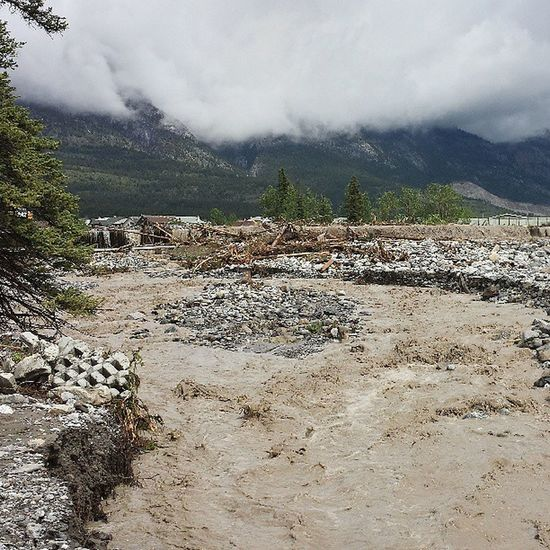 Just below Hwy in Canmore why road is Closed . Lots of Debris , parts of yards and homes