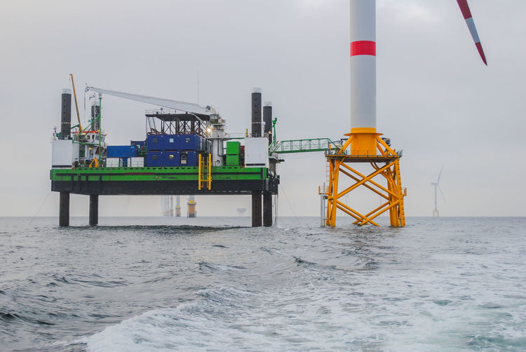 Schleswig Holstein - North Sea, Germany - January 06, 2018: Wind energy company repower is building a wind farm in Schleswig Holstein - North Sea, by Natascha Kaukorat Nature Nuclear Disposal Offshore Offshore Wind Farm Sustainable Development Wind Turbine Wind Power Alternative Energy Co2 Coast Electricity  Energy Energy Industry Energy Transition Environmentally Friendly Generator Green Electricity Power Generation Recycling Renewable Energy Resources Technology Turbine Wind Farm