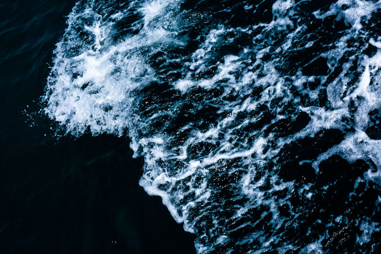 Flowing water . Blue Wave Aquatic Sport Beauty In Nature Blue Blurred Motion Close-up Day Flowing Water Motion Nature No People Ocean Outdoors Power In Nature Rock Rock - Object Sea Solid Splashing Sponge Sponge Water Sport Water Wave